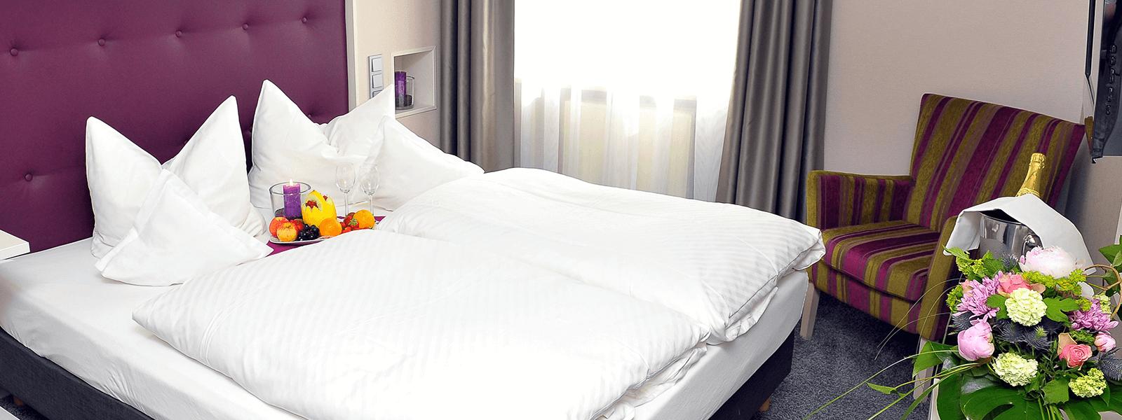 Doppelbett im Landblick Zimmer